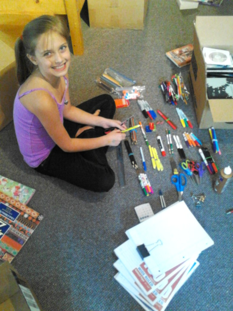 Elise organizing school supplies. She is a gifted organizer and her help has been invaluable.