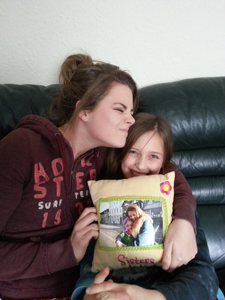 Elise giving Jess her Christmas present early before Jess goes back to Canada for the holidays