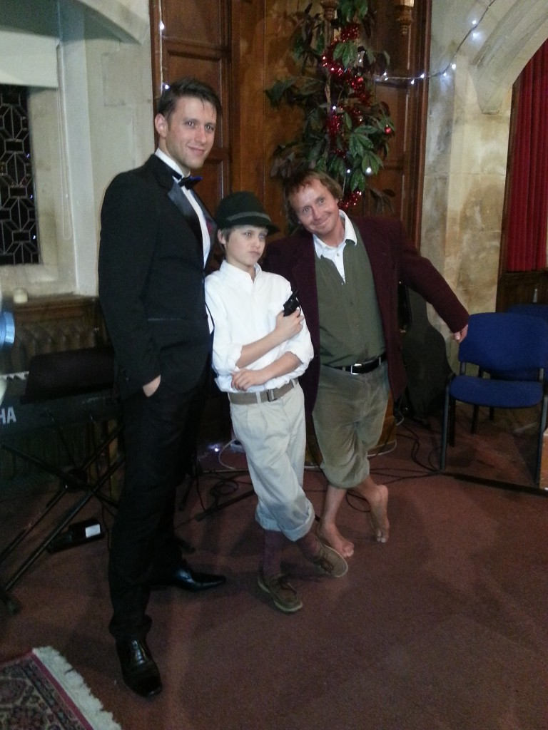 James, Wesley, and Paul still in costume from the carol service. James played James bond, Paul played Bilbo Baggins, and Wesley was a Van Trapp kid (with an authentic Austrian hat)
