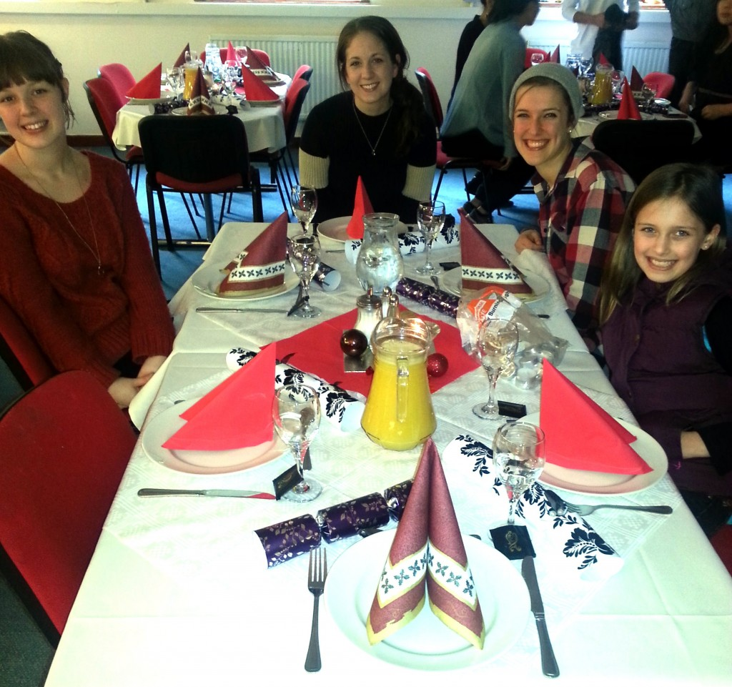 Rachael, Haley, Me, and Elise sitting at one of the tables in Cedars for Christmas lunch