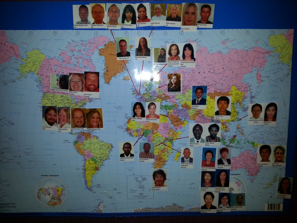 The NETS board showing each students picture and where they live in the world